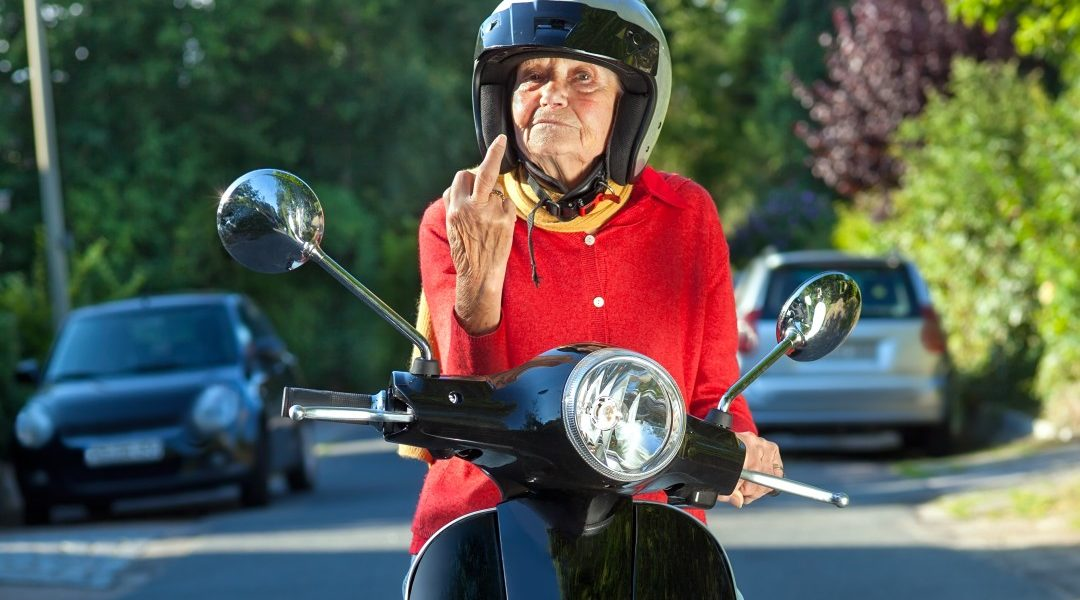 Lady on scooter giving the bird_innovAGEING