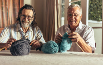 innovAGEING Merlin Kong two men knitting Age Services